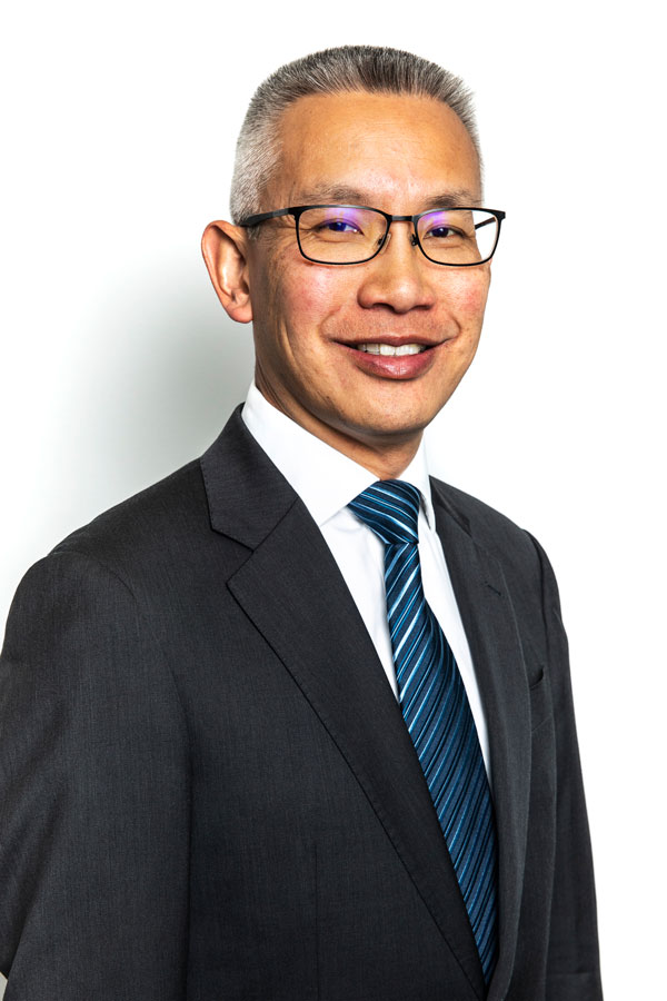 Headshot photo of Greg Hing from PCO Law
